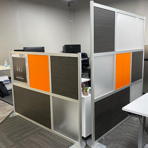 Shive location in omaha - interior of a building with orange and black panel cubicle dividers